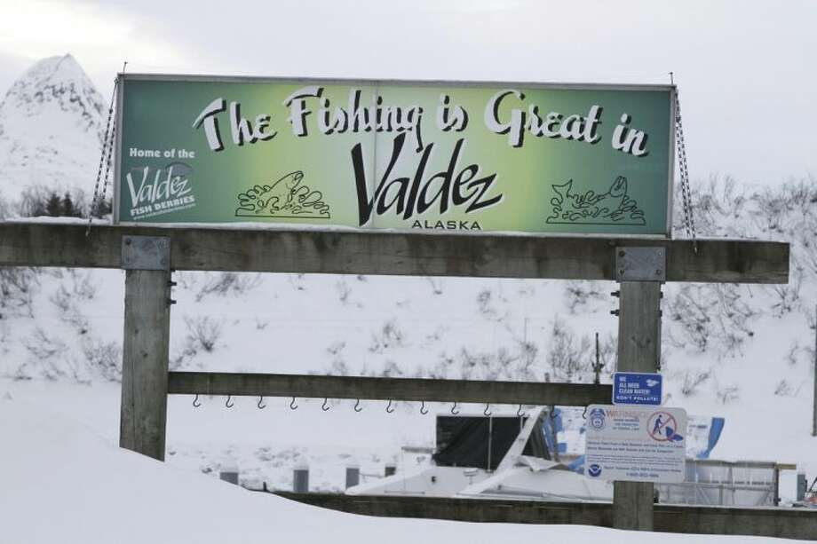 In this photo taken Feb. 26, 2014, is a sign hanging outside the small boat harbor in Valdez, Alaska. When the Exxon Valdez ran aground in March 1989, spilling nearly 11 million gallons of crude in Prince William Sound, many fisheries were hurt by the disaster and many fishermen lost boats or homes. (AP Photo/Mark Thiessen)