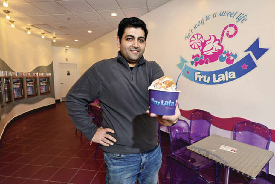 Hour photo / Erik Trautmann Mohit Malhotra and his wife Mona have opened a new frozen yogurt shop with a twist on Main Ave. Fru Lala will serve fresh crepes and baked goods along with a slew of frozen yogurt flavors as well as ice cream.