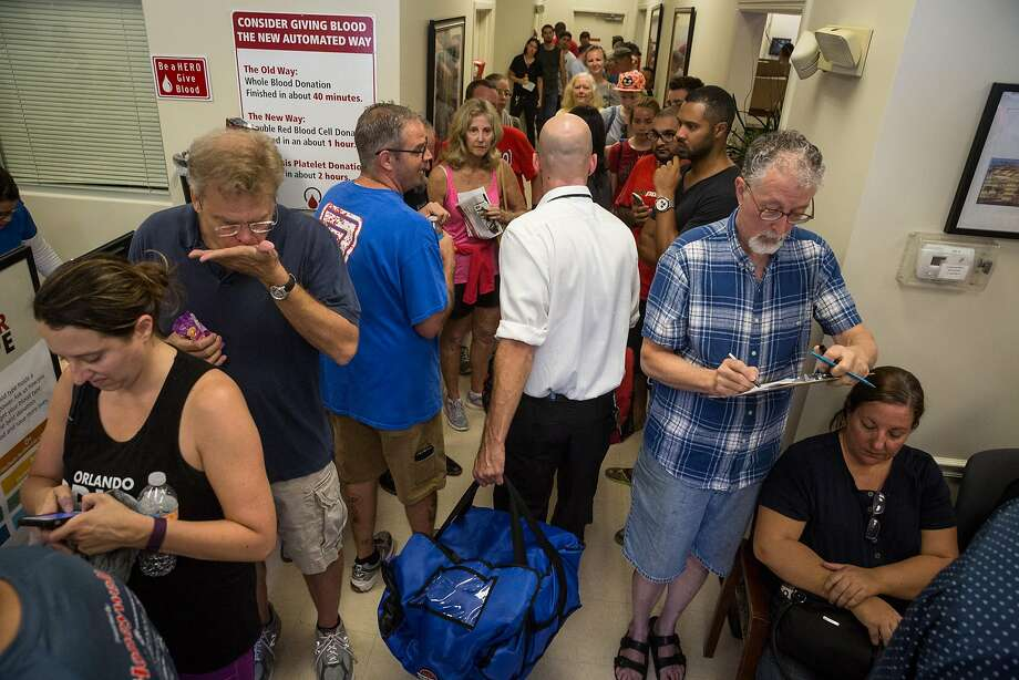 People line up to give blood Sunday at the OneBlood center in Orlando after the attack at the Pulse nightclub. Many gay and bisexual men have expressed frustration with federal rules that prevent them from donating blood in response to such a tragedy. Photo: Loren Elliott, TNS