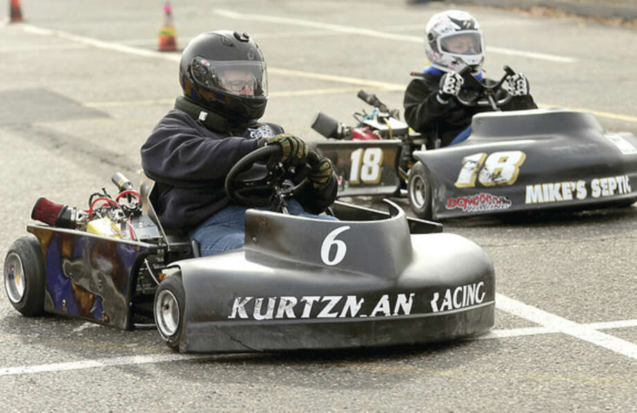 Hour photo / Erik Trautmann Councilwoman Michelle Magglio and Town Clerk Rick McQuaid race in the inaugural Norwalk Karting Association Mayor's Cup Saturday at Calf Pasture Beach.