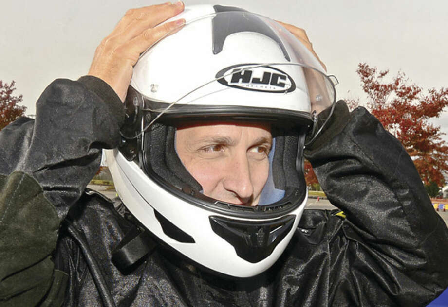 Hour photo / Erik Trautmann State Senator Bob Duff readies to race in the inaugural Norwalk Karting Association Mayor's Cup Saturday at Calf Pasture Beach.