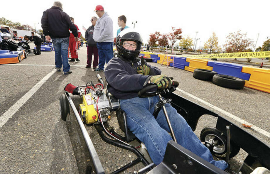 Hour photo / Erik Trautmann Town Clerk Rick McQuaid gets ready to race in the inaugural Norwalk Karting Association Mayor's Cup Saturday at Calf Pasture Beach.