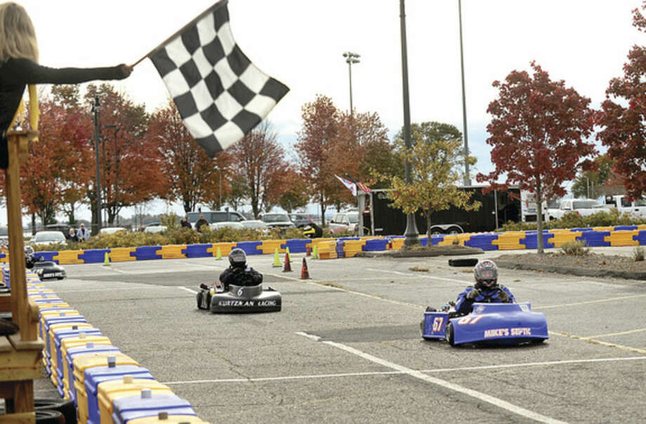 Hour photos/Erik TrautmannNorwalk Mayor Harry Rilling, state Sen. Bob Duff, Councilwoman Michelle Magglio, and Town Clerk Rick McQuaid race in the inaugural Norwalk Karting Association Mayor's Cup Saturday at Calf Pasture Beach.