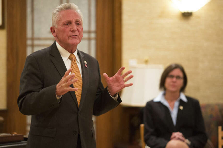 """Hour photo/Chris Palermo Norwalk Mayor Harry Rilling speaks alongside his runningmate Kelly Straniti at the """"Meet the Candidates"""" event hosted by the East Norwalk Business Association at 25 Van Zant St. Tuesday night."""