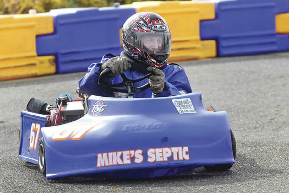Hour photo / Erik Trautmann Norwalk Mayor Harry Rilling races in his inaugural Norwalk Karting Association Mayor's Cup Saturday at Calf Pasture Beach.