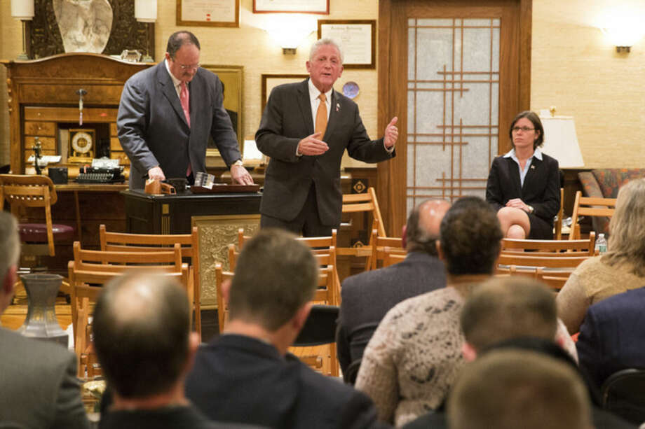 "Hour photo/Chris Palermo Norwalk Mayor Harry Rilling speaks alongside his runningmate Kelly Straniti and mediator Winthrop Baum at the ""Meet the Candidates"" event hosted by the East Norwalk Business Association at 25 Van Zant St. Tuesday night."