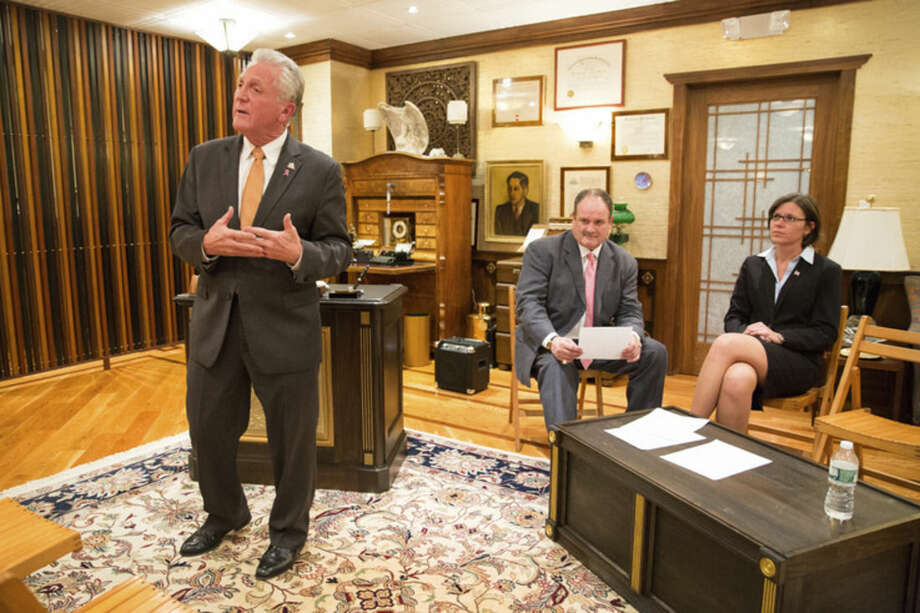 "Hour photo/Chris PalermoNorwalk Mayor Harry Rilling speaks while his Republican challenger Kelly Straniti and mediator Winthrop Baum are seated at the ""Meet the Candidates"" event held by the East Norwalk Business Association at 25 Van Zant St. Tuesday night."