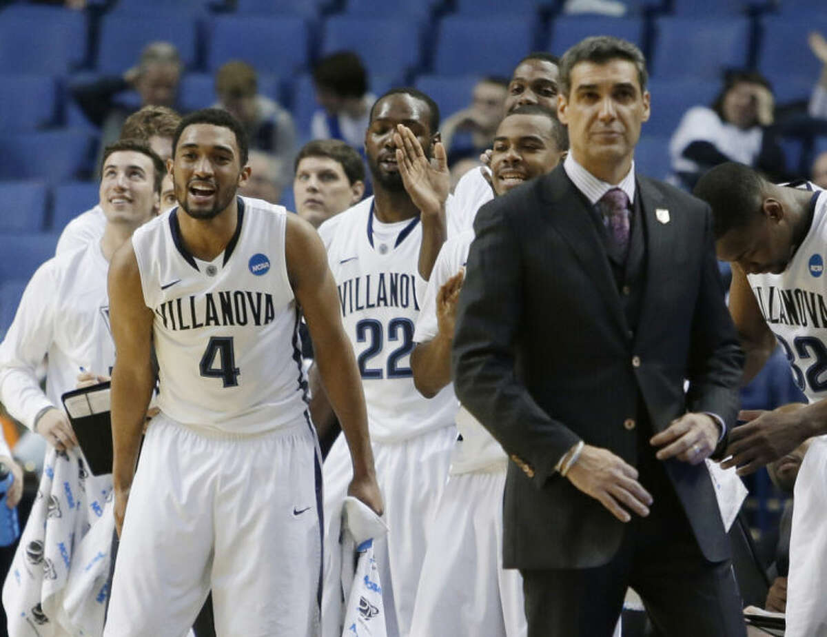 Villanova's Darrun Hilliard II (4) celebrates with teammates during second half of a second-round game against Milwaukee in the NCAA college basketball tournament in Buffalo, N.Y., Thursday, March 20, 2014. Villanova won 73-53. (AP Photo/Nick LoVerde)