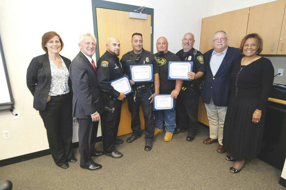 Hour photo/Alex von KleydorffThe Norwalk Police Commission and the officers of the month for September. L-R Deputy Chief Susan Zecca, Mayor Harry Rilling, Officer Vidal Goñez, Officer Richard Delallo, Officer Mark Suda, Officer Russell Ouelette, along with Commissioners Charlie Yost and Fran Collier-Clemmons.
