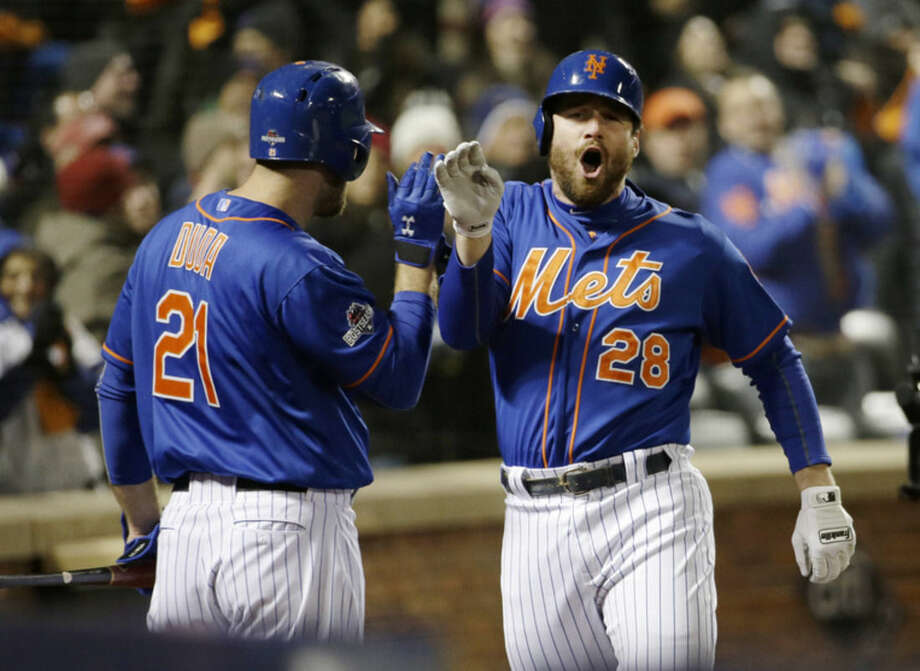 New York Mets' Daniel Murphy is congratulated by teammate Lucas Duda after hitting a two-run home run during the first inning of Game 2 of the National League baseball championship series against the Chicago Cubs Sunday, Oct. 18, 2015, in New York. (AP Photo/David J. Phillip)