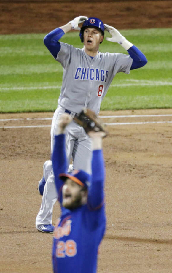 New York Mets' Daniel Murphy (28) reacts after teammate Curtis Granderson caught a ball hit by Chicago Cubs' Chris Coghlan (8) at the wall during the second inning of Game 2 of the National League baseball championship series Sunday, Oct. 18, 2015, in New York. (AP Photo/David Goldman)