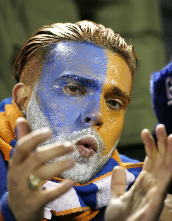 A New York Mets fan cheers during the seventh inning of Game 2 of the National League baseball championship series against the Chicago Cubs Sunday, Oct. 18, 2015, in New York. (AP Photo/David J. Phillip)