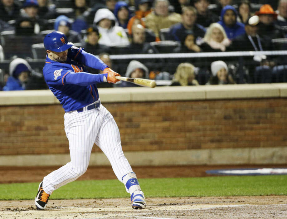 New York Mets' David Wright hits an RBI double during the first inning of Game 2 of the National League baseball championship series against the Chicago Cubs Sunday, Oct. 18, 2015, in New York. (AP Photo/David J. Phillip)