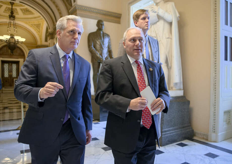 House Majority Leader Kevin McCarthy of Calif., left, and House Majority Whip Steve Scalise of La., stride from the House chamber on Capitol Hill in Washington, Wednesday, Nov. 18, 2015, as House Republicans work on legislation aimed at increasing screenings for Syrian and Iraqi refugees before they enter the U.S., including a new requirement for FBI background checks. (AP Photo/J. Scott Applewhite)