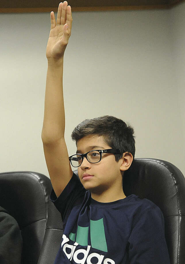 Hour photo/Matthew VinciChristian Iosifides, an eighth-grade student from West Rocks Middle School, participates in the Peer Outreach Group that meets at Norwalk City Hall every Monday night.