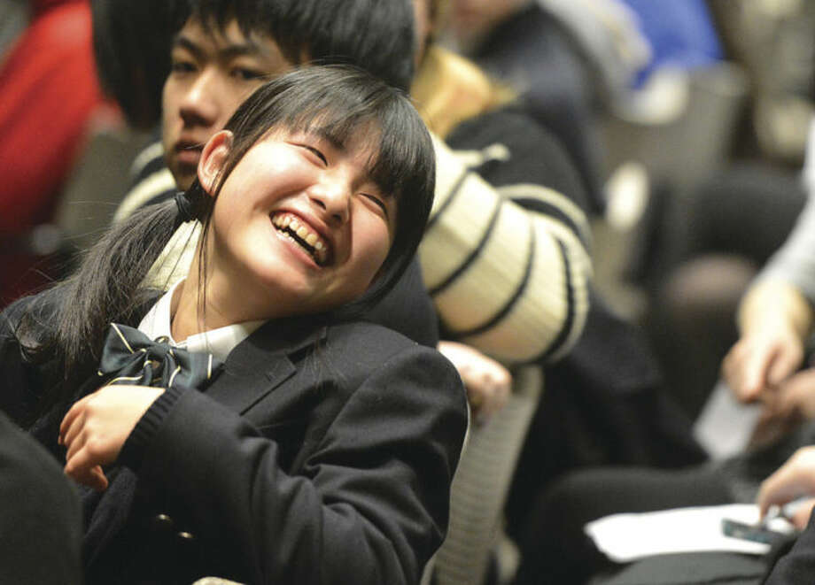 Hour Photo/Alex von Kleydorff Kojo High School student Ayano Yuki smiles as she laughs with others gathered during a program to celebrate 20 years of International Exchanges at the Center for Global Studies at Brien McMahon High School