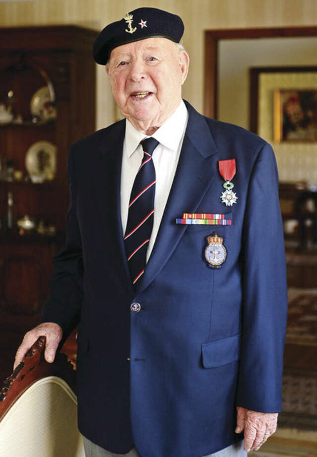 Hour photo/Erik TrautmannWilton resident Trygve Hansen was recently awarded the Legion of Honor medal from the French Consul General for his service during World War ll with the Norwegian Navy.