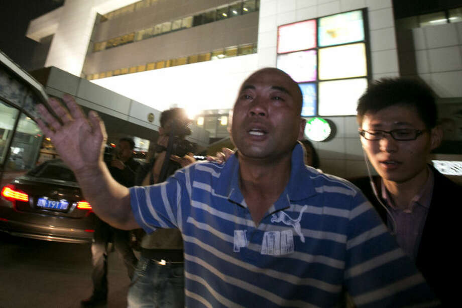 A relative of one of the Chinese passengers aboard the Malaysia Airlines jet, MH370, runs out of the hotel in tears after being told of the latest news in Beijing, China, Monday, March 24, 2014. It was the grim news that families of the missing Malaysian Airlines flight had dreaded for weeks, and on Monday they heard it from Malaysia's prime minister: new analysis of satellite data indicates the missing plane crashed into a remote corner of the Indian Ocean. (AP Photo/Ng Han Guan)