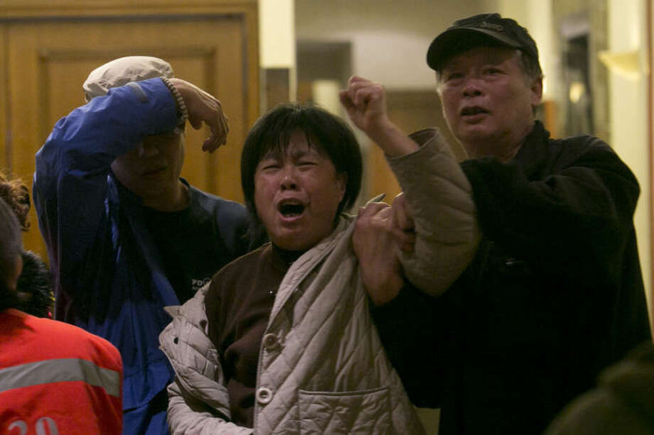 "A relative of one of the Chinese passengers aboard the Malaysia Airlines, MH370 grieves after being told of the latest news in Beijing, China, Monday, March 24, 2014. A new analysis of satellite data indicates the missing Malaysia Airlines plane crashed into a remote corner of the Indian Ocean, Malaysian Prime Minister Najib Razak said Monday. Malaysia Airlines said in a statement to the families that ""our prayers go out to all the loved ones of the 226 passengers and of our 13 friends and colleagues at this enormously painful time."" (AP Photo/Ng Han Guan)"
