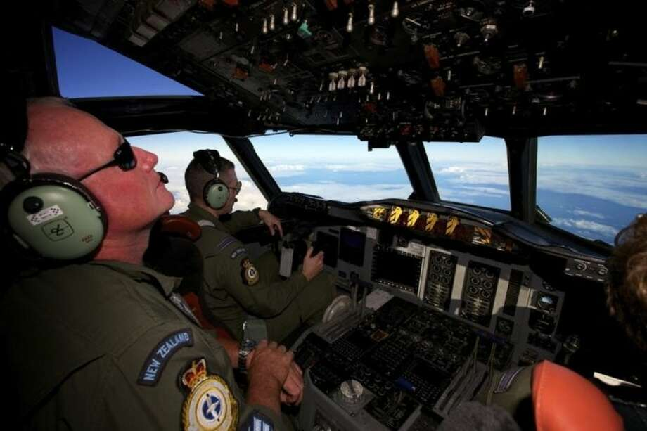 A Royal New Zealand Air Force P-3 Orion is flown by Flt. Lt Tim McAlevey back, in the search for missing Malaysia Airlines Flight MH370 over the Indian Ocean, Friday, April 11, 2014. Authorities are confident that signals detected deep in the Indian Ocean are from the missing Malaysian jet's black boxes, Australia's Prime Minister Tony Abbott said Friday, raising hopes they are close to solving one of aviation's most perplexing mysteries. (AP Photo/Richard Wainwright, Pool)