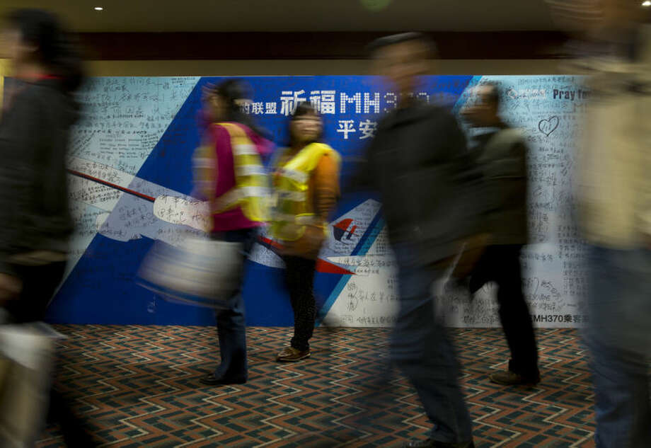 Relatives of Chinese passengers aboard the missing Malaysia Airlines flight MH370 leave the conference room after they attending a briefing held by Malaysia officials at a hotel in Beijing, China Friday, April 11, 2014. Authorities are confident that signals detected deep in the Indian Ocean are from the missing Malaysian jet's black boxes, Australia's Prime Minister Tony Abbott said Friday, raising hopes they are near solving one of aviation's most perplexing mysteries. (AP Photo/Andy Wong)
