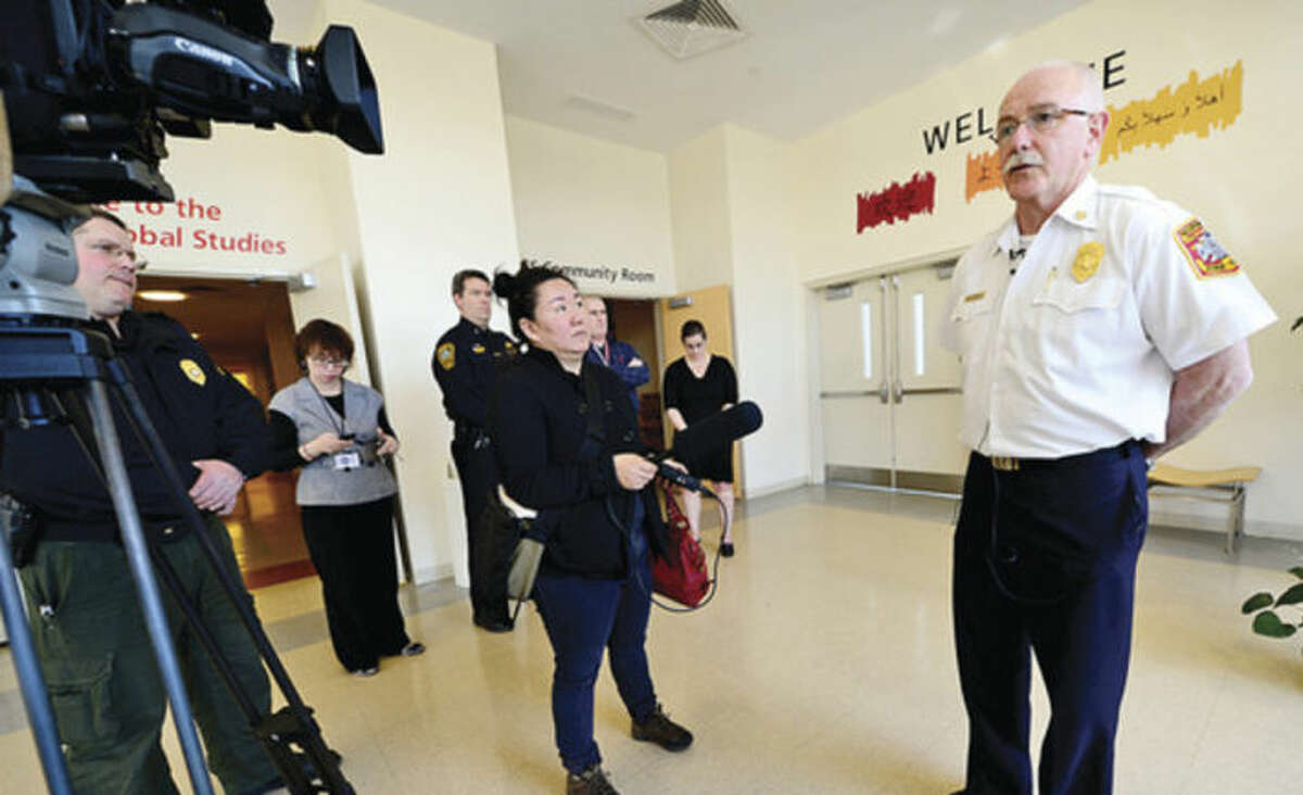 Hour photo / Erik Trautmann Norwalk Fire Chief Denis McCarthy gives statement to the media after a closed door school safety exercise at Brien McMahion High School Thursday.