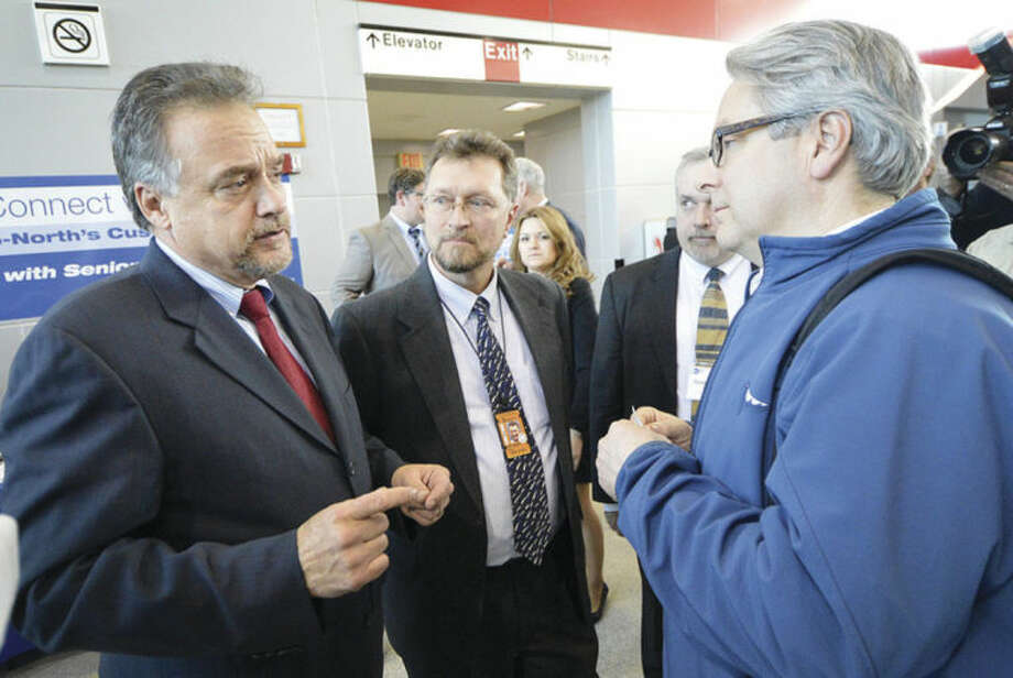 Hour photo / Alex von KleydorffMetro-North President Joe Giulietti and Senior Management speak with commuters like Lee Cockey from Milford during Connect with Us meeting at The Stamford Transportation Center