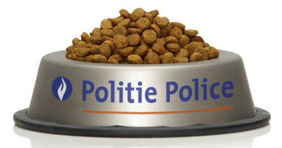 In this handout photo released by the Belgian Federal Police and placed on the social media site Twitter, a bowl of cat food with the name of the police force on Monday, Nov. 23, 2015. Late Sunday, Nov. 22, 2015 the Belgian Federal Police asked people to stop commenting on ongoing raids in social media to avoid tipping off suspects who could be checking their tweets for suspicious activities in their neighborhood. En masse, they did more than that. The hashtag #BrusselsLockdown suddenly shifted from serious to humorous, tweeting a flood of pictures of all-too-innocent cats in all kinds of situations. (Belgian Federal Police via AP)