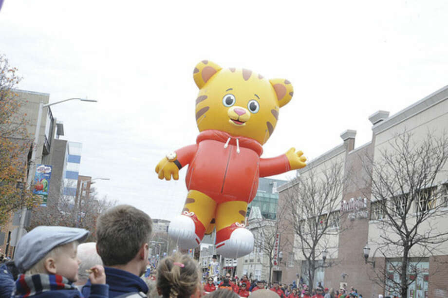 Hour photo/Matthew VinciDaniel Tiger, from Daniel Tiger's Neighborhood, floats along the parade route of Stamford's annual UBS Parade Spectacular.