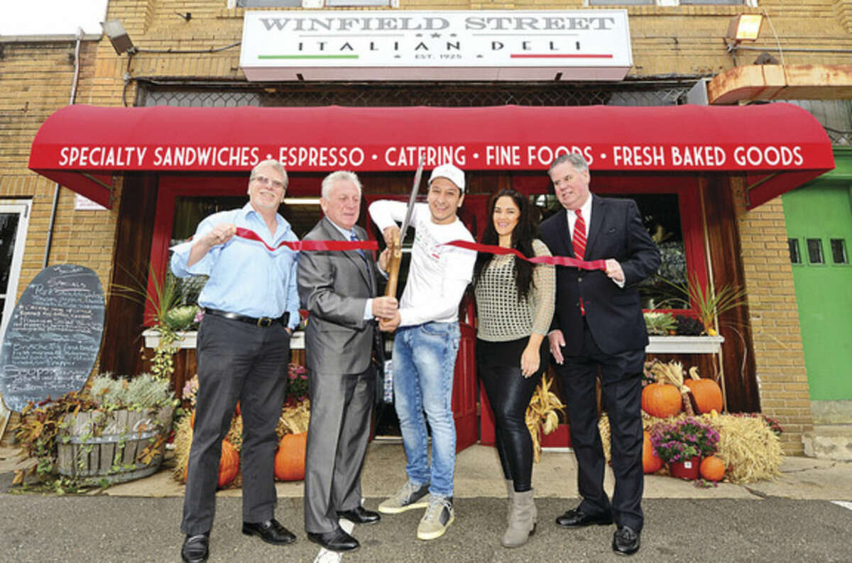 Hour photo / Erik Trautmann Matthew Mandell of the Weston / Weston Chamber of Commerce and Norwalk Mayor Harry Rilling join, Reno Donatti, new owner of the Winfield Street Deli, his wife, Jeanette Donatti, and Greater Norwalk Chamber of Commerce Ed Musante, at 69 Winfield St. Thursday morning for a ribbon cutting ceremony.