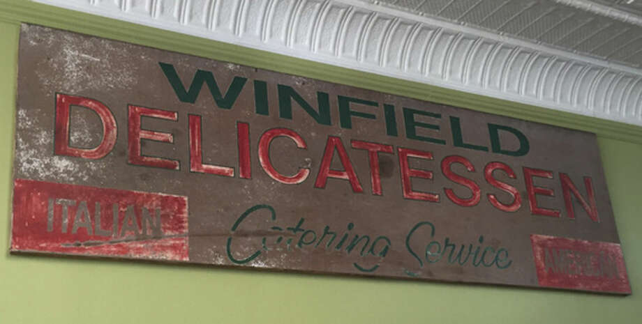Hour photo / Chris BosakAn old sign for Winfield Deli, found by the new owner.