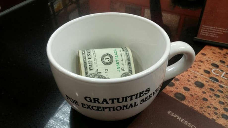 Photo by Frank WhitmanCoffee shop tip mug.