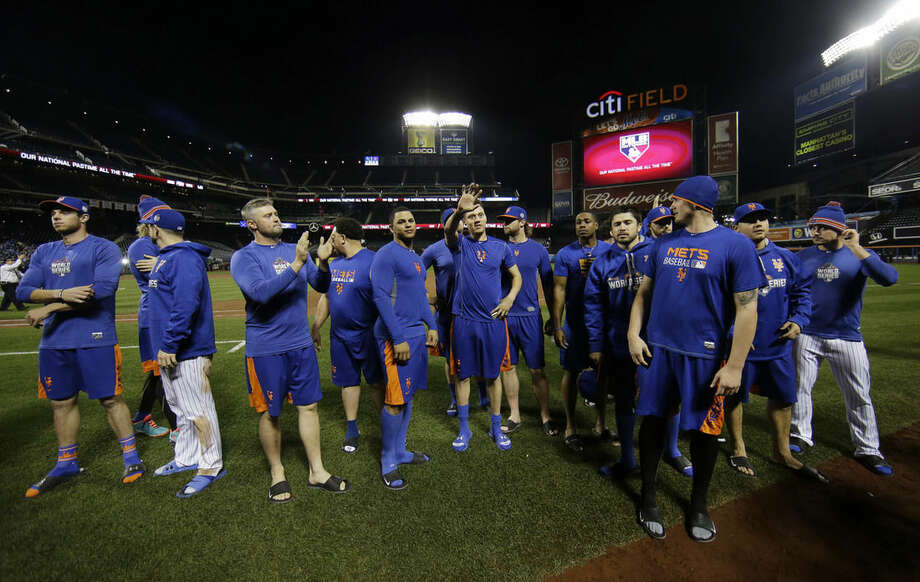 New York Mets applaud their fans after Game 5 of the Major League Baseball World Series against the Kansas City Royals Monday, Nov. 2, 2015, in New York. The Royals won 7-2 to win the series. (AP Photo/Matt Slocum)