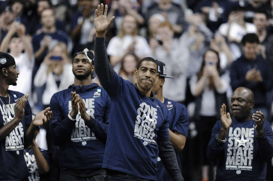 Connecticut coach Kevin Ollie waves to fans at a pep rally Tuesday, April 8, 2014, in Storrs, Conn., the day after the team won the NCAA men's Division I basketball championship. (AP Photo/Jessica Hill)