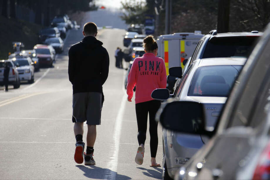 Studentswalk down the street away from the campus of the Franklin Regional School District, where several people were stabbed at Franklin Regional High School, on Wednesday, April 9, 2014, in Murrysville, Pa., near Pittsburgh. The suspect, a male student, was taken into custody and being questioned. (AP Photo/Gene Puskar)