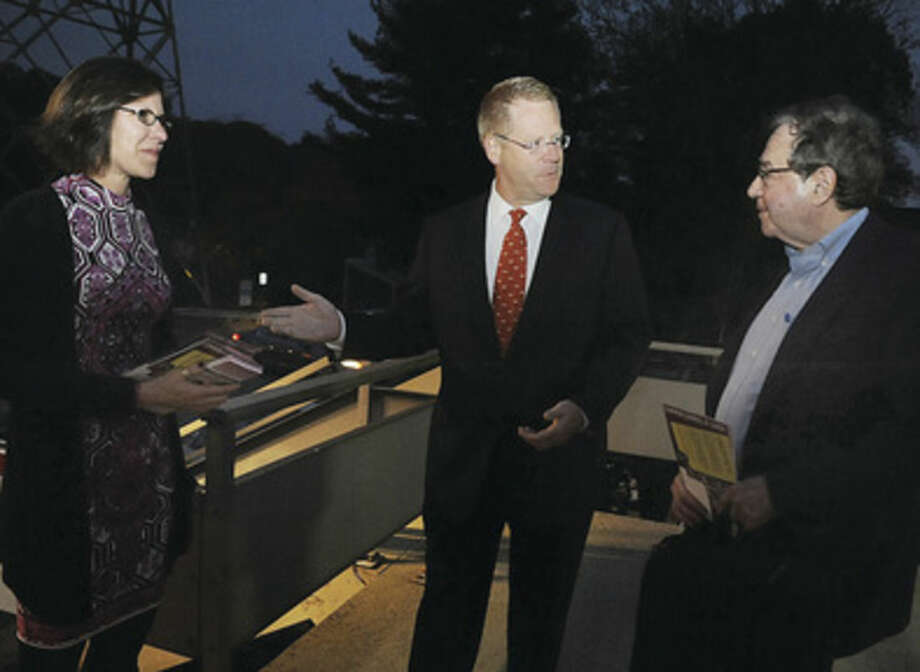 Norwalk mayoral candidate Kelly Straniti, along with David McCarthy and Enrique Santiago, greet and hand out information to Dennis Liebowitz Monday night at the Rowayton train station as they met commuters on the evening rush.