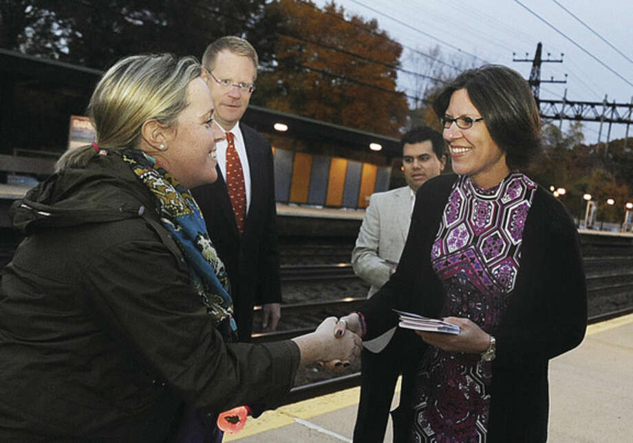 Above right, Norwalk mayoral candidate Kelly Straniti, along with David McCarthy and Enrique Santiago, greet and hand out information to Devon Skehan Monday night at the Rowayton train station as they met commuters on the evening rush.Hour photo/Matthew Vinci