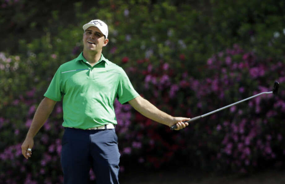 Gary Woodland reacts after missing an eagle on the 13th hole during the second round of the Masters golf tournament Friday, April 11, 2014, in Augusta, Ga. (AP Photo/David J. Phillip)
