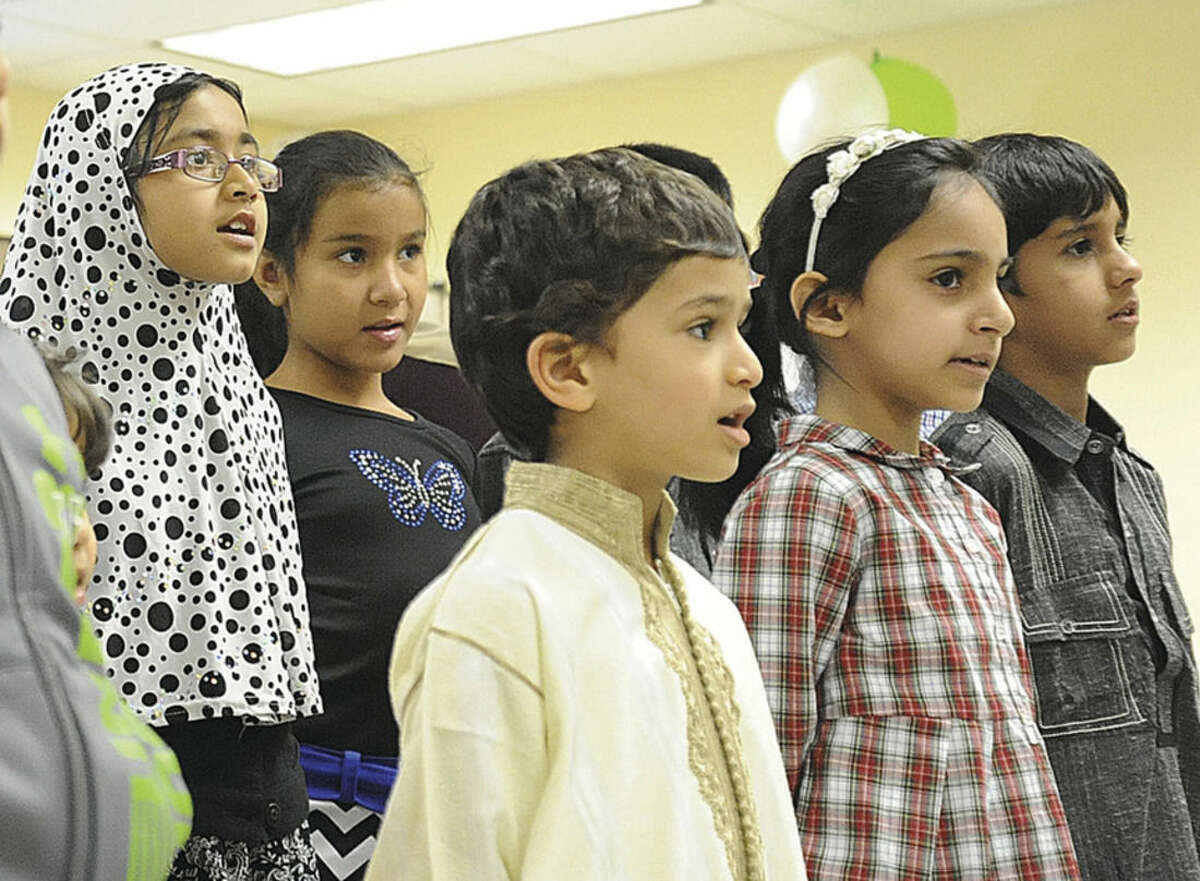 Children sing Sunday at the ICCNY Islamic Culteral Center in Stamford as part of the celebration of the Prophet Mohamed's birthday. Hour photo/Matthew Vinci