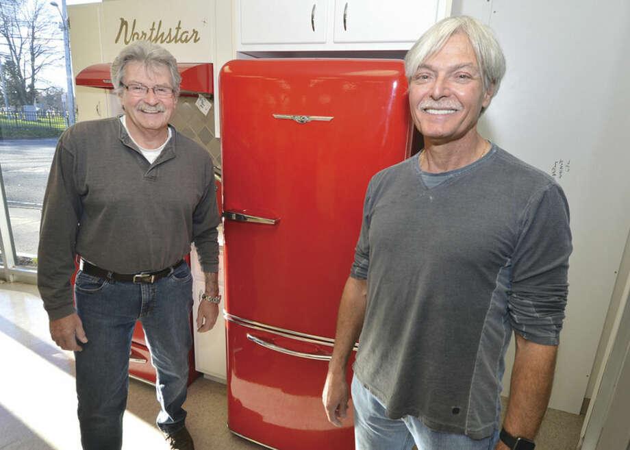 Hour photo/Alex von KleydorffREO Appliance former owner Joe Esposito and new owner Michael Jordan in the showroom next to new Retro-look kitchen appliances.