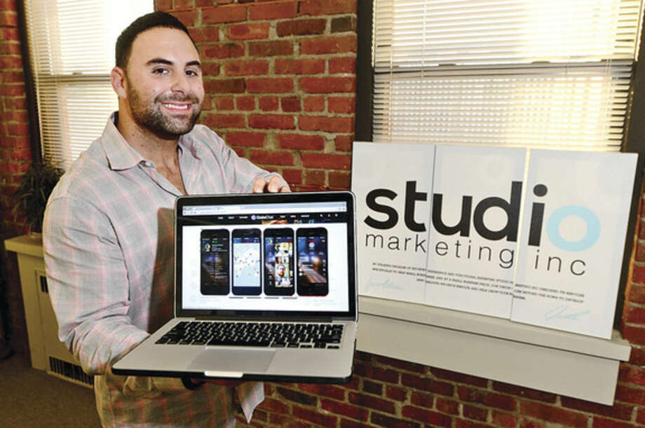 Hour photo / Erik TrautmannJason Petrini, owner and CEO of Studio Marketing, displays the new app Globe Chat ,which will be released in early 2016.