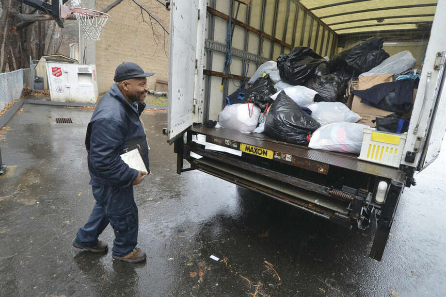 Hour photo/Alex von KleydorffDriver James Phillips loads a truck with donations from the Salvation Army drop-off boxes in Norwalk.