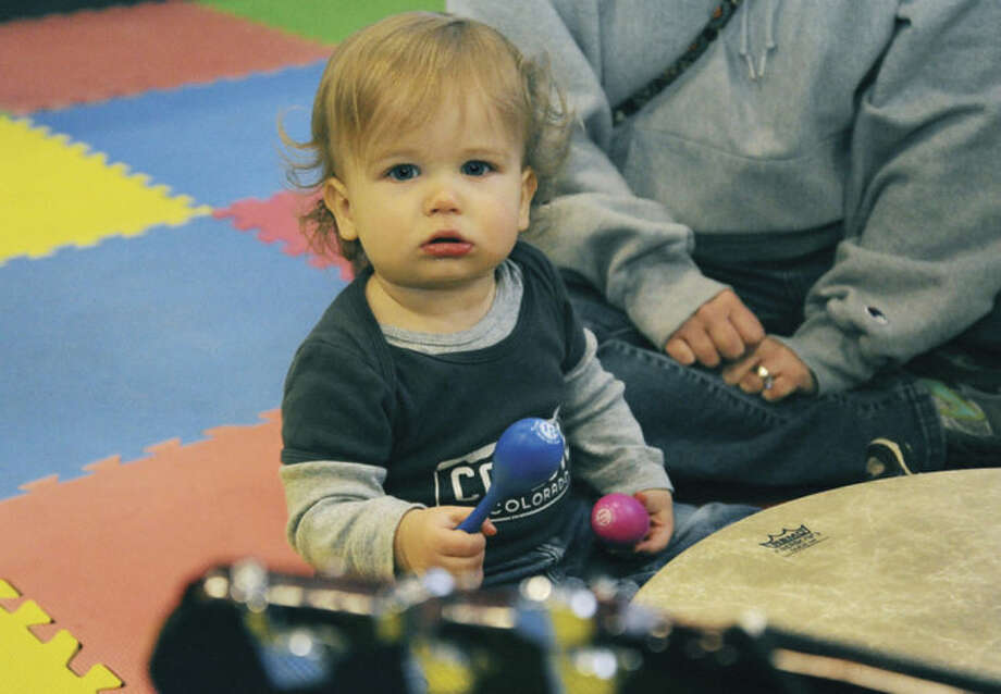 Everett Nieman, 14 months old, gets into the music with Music Together of Fairfield County Sunday at Kids Fest held in the Wilton High School Field House.