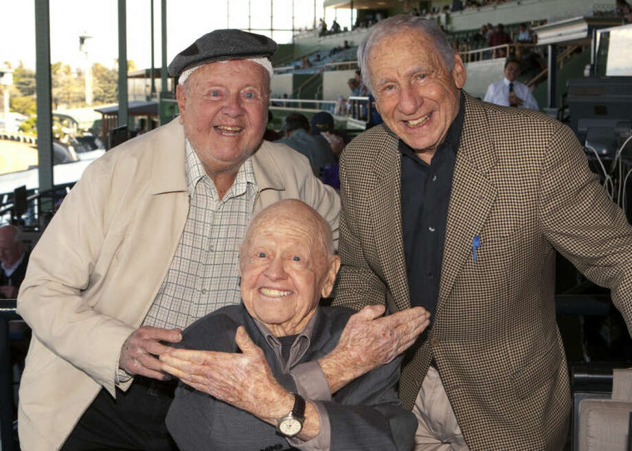 FILE - In this Sunday, March 30, 2014, file photo, entertainment icons Dick Van Patten, left, and Mel Brooks flank Mickey Rooney at Santa Anita Park, in Arcadia Calif. Rooney, a Hollywood legend whose career spanned more than 80 years, has died. He was 93. Los Angeles Police Commander Andrew Smith said that Rooney was with his family when he died Sunday, April 6, 2014, at his North Hollywood home. (AP Photo/Benoit Photo, File)