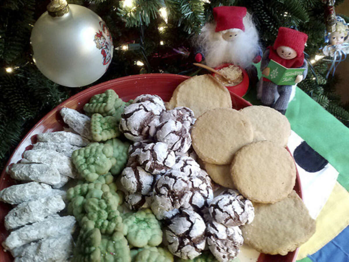 Photo by Frank Whitman Pecan fingers, Christmas trees, chocolate crinkles and sugar cookies by the tree.
