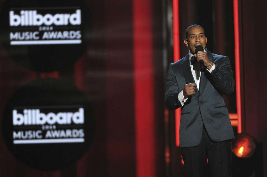 Ludacris speaks on stage at the Billboard Music Awards at the MGM Grand Garden Arena on Sunday, May 18, 2014, in Las Vegas. (Photo by Chris Pizzello/Invision/AP)