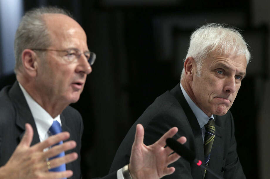 Hans Dieter Poetsch, chairman of the board of directors of Volkswagen, left, and Matthias Mueller, CEO of Volkswagen, right, address the media during a press conference of the German car manufacturer Volkswagen in Wolfsburg, Germany, Thursday, Dec. 10, 2015. (AP Photo/Michael Sohn)