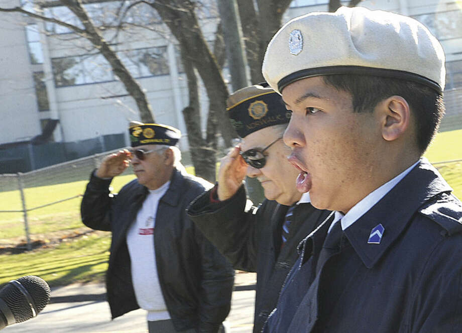 Hour photo/Matthew VinciNorwalk High School cadet James Hobayan sings the National Anthem at the Veteran of the Month ceremony honoring David R. Fahey Jr. Sunday at the American Legion Post 12.