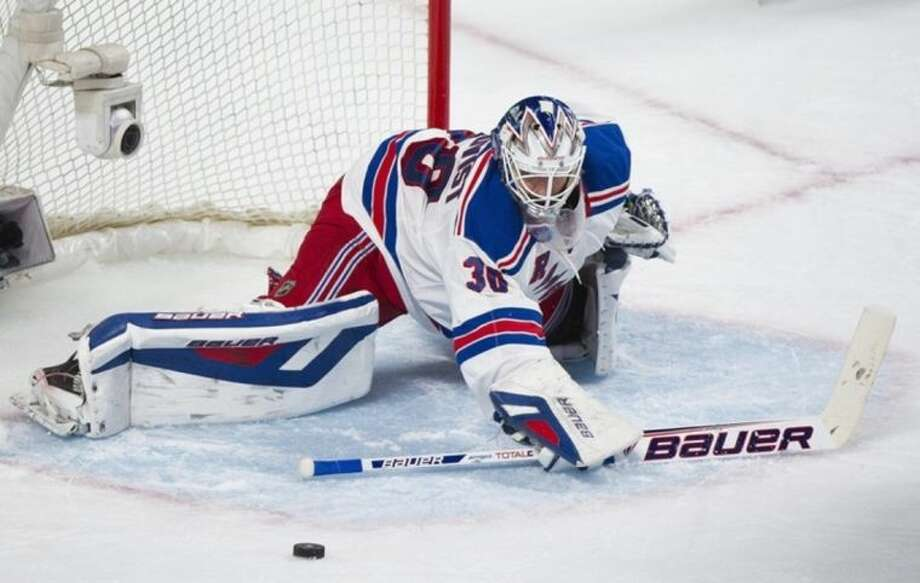 New York Rangers' goaltender Henrik Lundqvist makes a save against the Montreal Canadiens during the second period in Game 2 of the NHL hockey Eastern Conference final Stanley Cup playoff game in Montreal, Monday, May 19, 2014. (AP Photo/The Canadian Press, Graham Hughes)