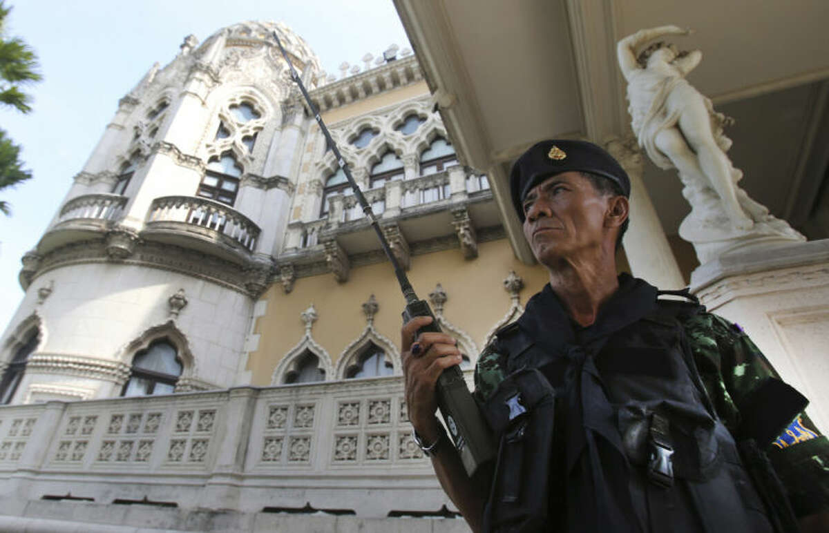 A Thai soldier guards outside Government House compound of prime minister's office,in Bangkok, Thailand, Tuesday, May 20, 2014. Thailand's army declared martial law before dawn Tuesday in a surprise announcement it said was aimed at keeping the country stable after six months of turbulent political unrest. The military, however, insisted a coup d?'etat was not underway. (AP Photo/Apichart Weerawong)